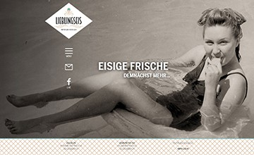 Screenshot: Website mit Herobild mit essender Frau am Strand